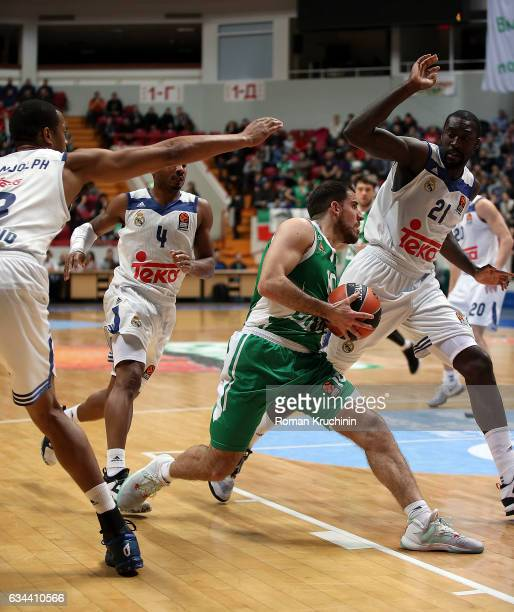 Quino Colom #10 of Unics Kazan competes with Othello Hunter #21 of Real Madrid during the 2016/2017 Turkish Airlines EuroLeague Regular Season Round...