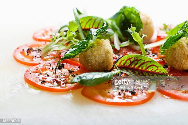 Quinoa and herb balls and tomato carpaccio with tapenade