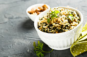 Quinoa salad with wild garlic and nuts