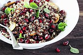Quinoa salad with pomegranate and nuts.Concept of healthy eating.