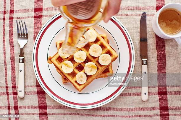 Quinoa waffles with banana slices and maple syrup