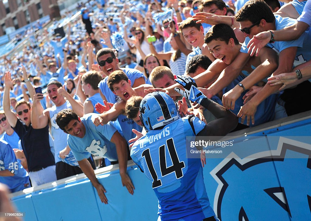 Quinshad Davis #14 of the North Carolina Tar Heels celebrates with fans after scoring a fourth-quarter touchdown against the Middle Tennessee State Blue Raiders during play at Kenan Stadium on September 7, 2013 in Chapel Hill, North Carolina. North Carolina won 40-20.