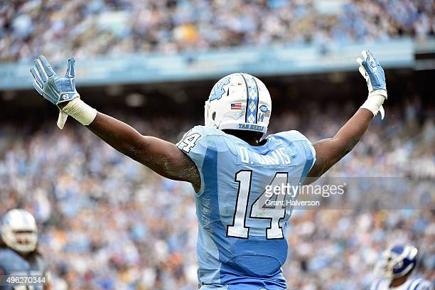 Quinshad Davis of the North Carolina Tar Heels reacts after scoring a touchdown against the Duke Blue Devils during their game at Kenan Stadium on...