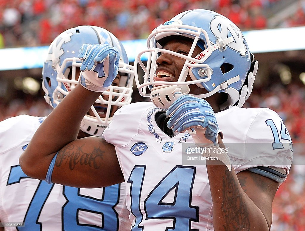 Quinshad Davis of the North Carolina Tar Heels sticks out his tongue as he celebrates after scoring a touchdown against the North Carolina State...
