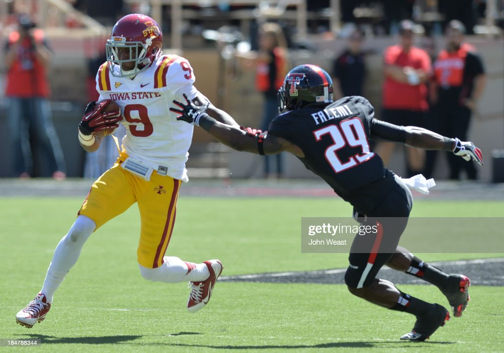 Quinten Bundrage #9 of the Iowa State Cyclones is chased by Olaoluwa Falemi #29 of the Texas Tech Red Raiders during game action on October 12, 2013 at AT&T Jones Stadium in Lubbock, Texas. Texas Tech won the game 42-35