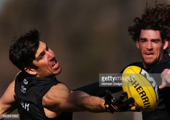Quinten Lynch making his comeback from injury competes for the ball against Tyson Goldsack during a Collingwood Magpies AFL training session at...