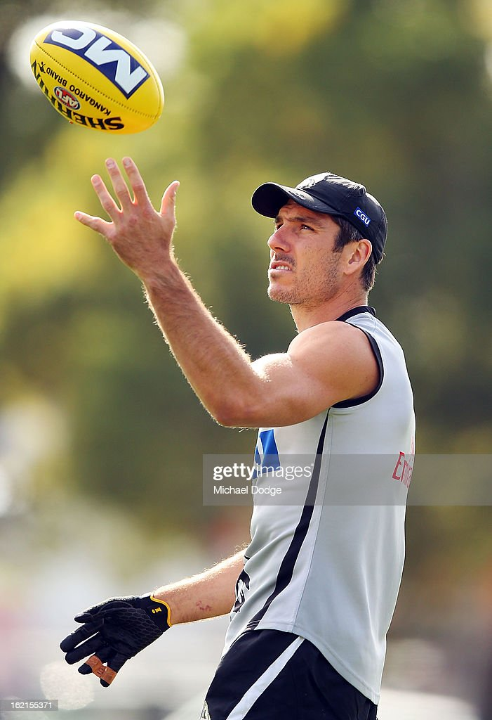 <a gi-track='captionPersonalityLinkClicked' href=/galleries/search?phrase=Quinten+Lynch&family=editorial&specificpeople=176560 ng-click='$event.stopPropagation()'>Quinten Lynch</a> marks theball with his left hand during a Collingwood Magpies AFL training session at Gosch's Paddock on February 20, 2013 in Melbourne, Australia.