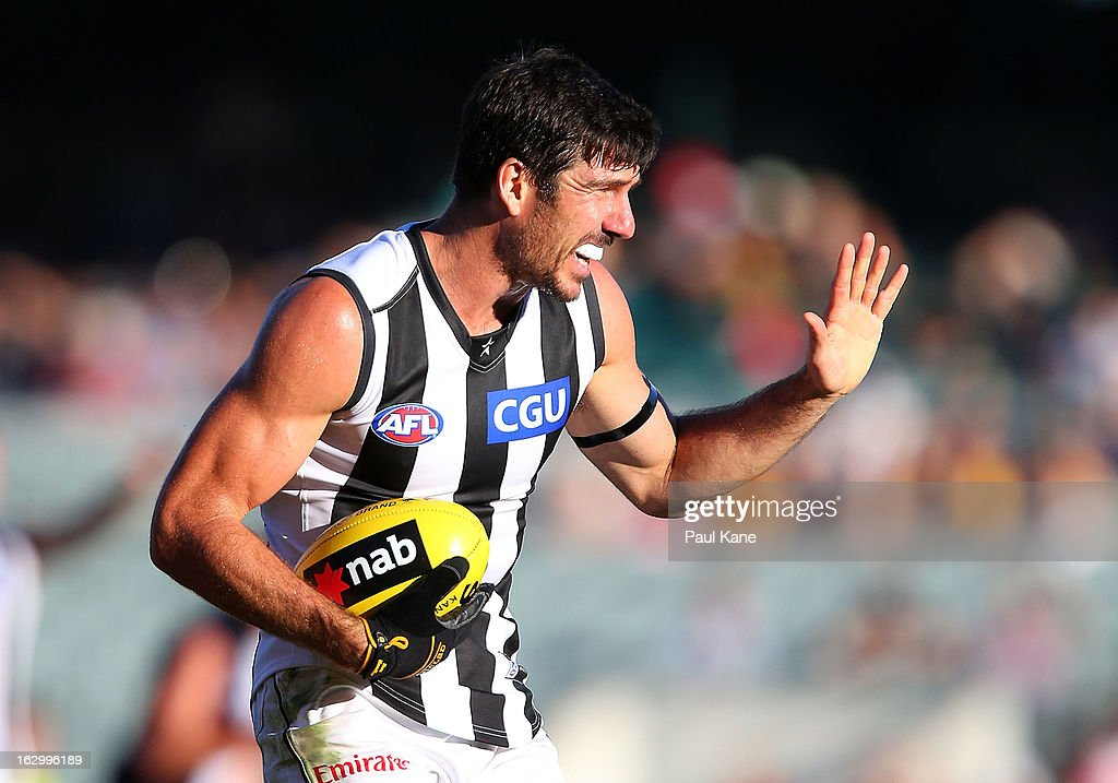 Quinten Lynch of the Magpies gestures to the forward line during the round two AFL NAB Cup match between the West Coast Eagles and the Collingwood Magpies at Patersons Stadium on March 3, 2013 in Perth, Australia.