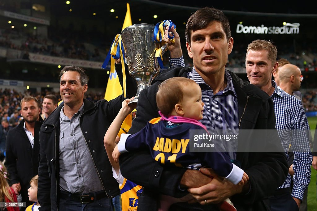 <a gi-track='captionPersonalityLinkClicked' href=/galleries/search?phrase=Quinten+Lynch&family=editorial&specificpeople=176560 ng-click='$event.stopPropagation()'>Quinten Lynch</a> walks a lap of honour with team mates celebrating the West Coast Eagles 2006 Premiership anniversary during the round 15 AFL match between the West Coast Eagles and the Essendon Bombers at Domain Stadium on June 30, 2016 in Perth, Australia.