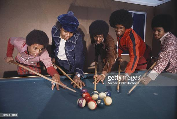 B quintet 'Jackson 5' pose for a portrait holding pool cues at home in 1972 in Los Angeles California LR Marlon Jackson Tito Jackson Jermaine Jackson...