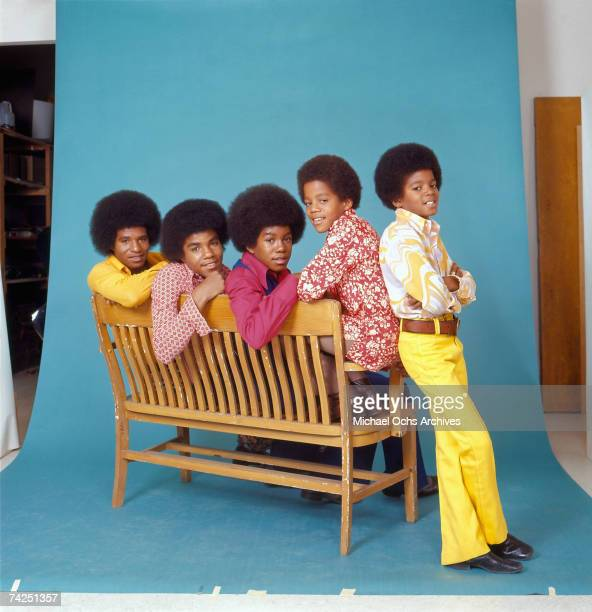 B quintet 'Jackson Five' pose for a studio portrait sitting on a bench in circa 1972 in Los Angeles California LR Tito Jackson Jackie Jackson...