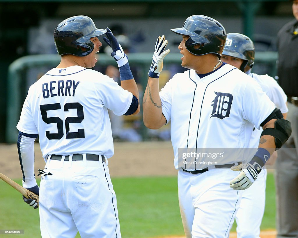 Quintin Berry #52 and Miguel Cabrera #24 of the Detroit Tigers celebrate Cabrera's 7th inning 2-run hiome run against the New York Yankees at Joker Marchant Stadium on March 23, 2013 in Lakeland, Florida. The Tigers defeated the Yankees 10-6.