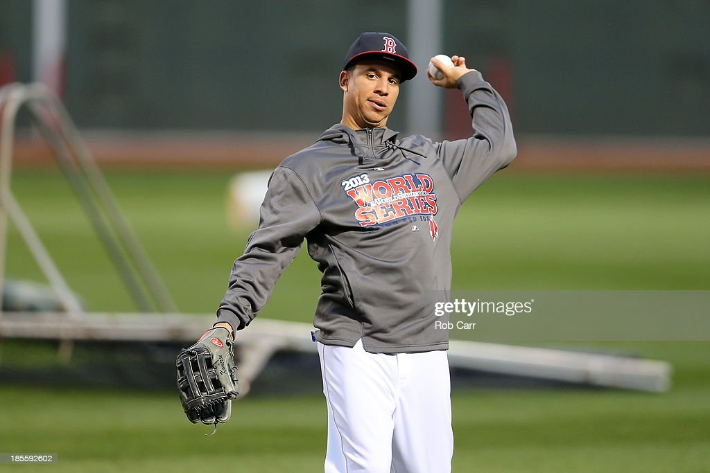 Quintin Berry #50 of the Boston Red Sox warms up during 2013 World Series Media Day at Fenway Park on October 22, 2013 in Boston, Massachusetts. The Red Sox host the Cardinals in Game 1 on October 23, 2013.