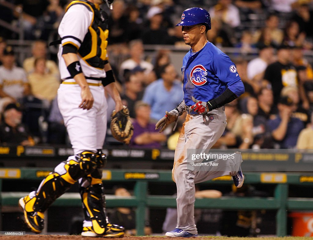 <a gi-track='captionPersonalityLinkClicked' href=/galleries/search?phrase=Quintin+Berry&family=editorial&specificpeople=6772125 ng-click='$event.stopPropagation()'>Quintin Berry</a> #5 of the Chicago Cubs scores on a sacrifice fly in the twelfth inning during the game against the Pittsburgh Pirates at PNC Park on September 16, 2015 in Pittsburgh, Pennsylvania.