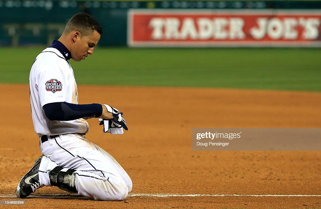 <a gi-track='captionPersonalityLinkClicked' href=/galleries/search?phrase=Quintin+Berry&family=editorial&specificpeople=6772125 ng-click='$event.stopPropagation()'>Quintin Berry</a> #52 of the Detroit Tigers reacts after being tagged out at first base by Brandon Belt #9 of the San Francisco Giants to end the fifth inning during Game Four of the Major League Baseball World Series at Comerica Park on October 28, 2012 in Detroit, Michigan.