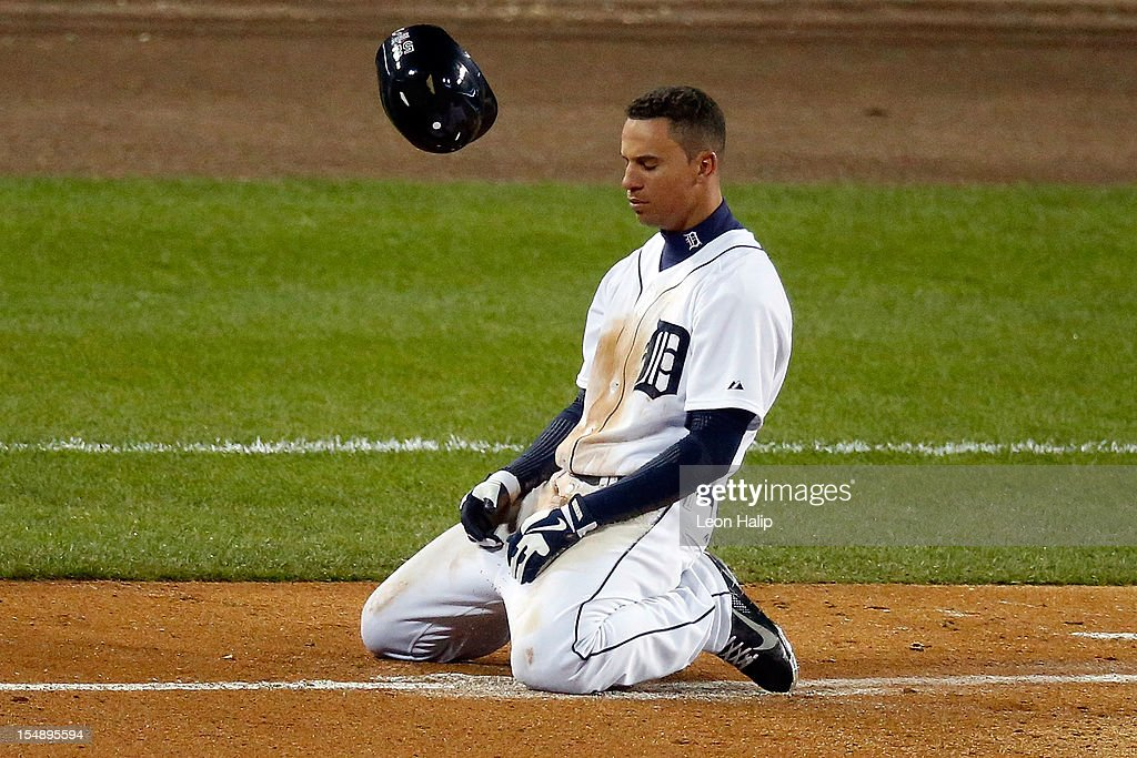 <a gi-track='captionPersonalityLinkClicked' href=/galleries/search?phrase=Quintin+Berry&family=editorial&specificpeople=6772125 ng-click='$event.stopPropagation()'>Quintin Berry</a> #52 of the Detroit Tigers reacts after getting tagged out at first base by Brandon Belt #9 of the San Francisco Giants after hitting a ground ball to Brandon Crawford #35 to end the fifth inning during Game Four of the Major League Baseball World Series at Comerica Park on October 28, 2012 in Detroit, Michigan.