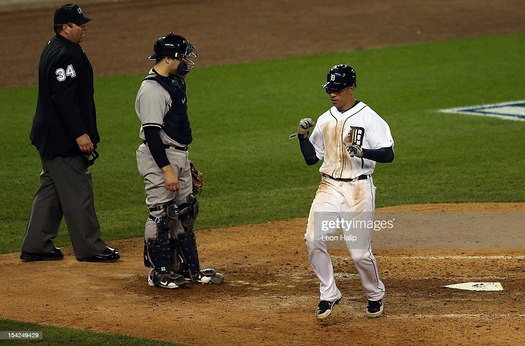 <a gi-track='captionPersonalityLinkClicked' href=/galleries/search?phrase=Quintin+Berry&family=editorial&specificpeople=6772125 ng-click='$event.stopPropagation()'>Quintin Berry</a> #52 of the Detroit Tigers reacts after he scored on a RBI double by Miguel Cabrera #24 in the bottom of the fifth inning against the New York Yankees during game three of the American League Championship Series at Comerica Park on October 16, 2012 in Detroit, Michigan.