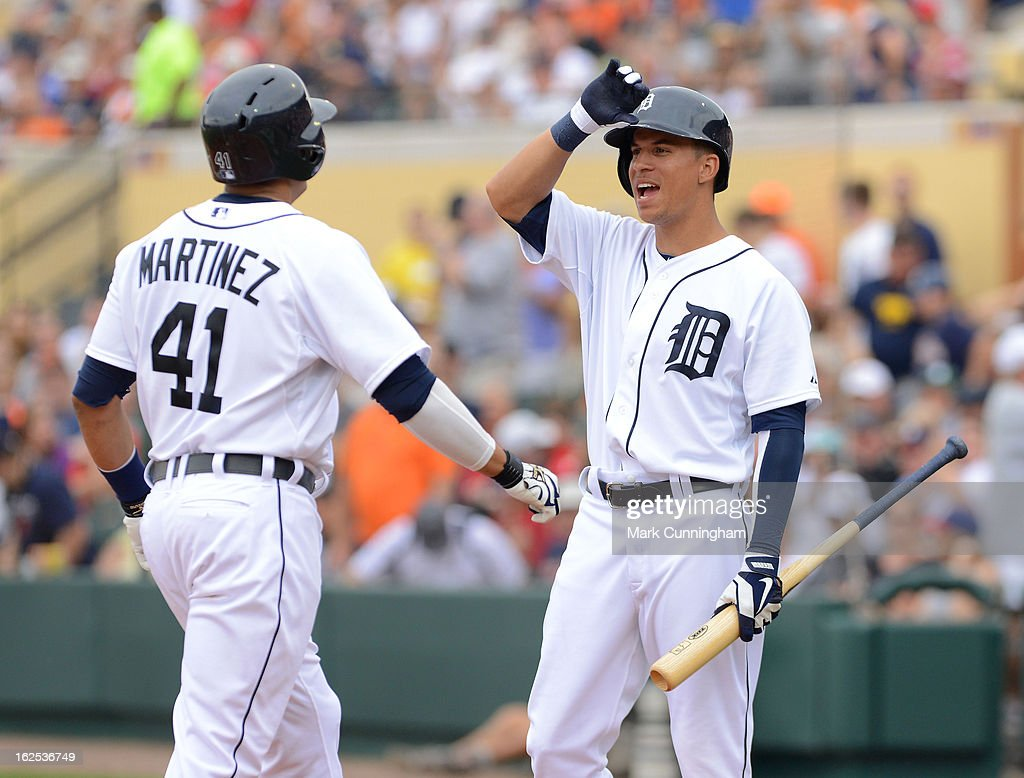 <a gi-track='captionPersonalityLinkClicked' href=/galleries/search?phrase=Quintin+Berry&family=editorial&specificpeople=6772125 ng-click='$event.stopPropagation()'>Quintin Berry</a> #52 of the Detroit Tigers waits to high-five Victor Martinez after Martinez hit a second inning home run against the Philadelphia Phillies during the spring training game at Joker Marchant Stadium on February 24, 2013 in Lakeland, Florida. The game ended in a 10 inning 5-5 tie.