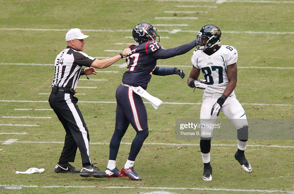 <a gi-track='captionPersonalityLinkClicked' href=/galleries/search?phrase=Quintin+Demps&family=editorial&specificpeople=5085122 ng-click='$event.stopPropagation()'>Quintin Demps</a> #27 of the Houston Texans hits Kevin Elliott #87 of the Jacksonville Jaguars after the play on November 18, 2012 at Reliant Stadium in Houston, Texas.
