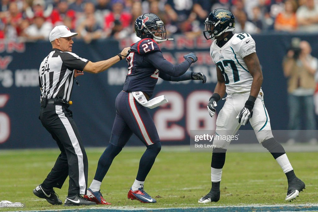 <a gi-track='captionPersonalityLinkClicked' href=/galleries/search?phrase=Quintin+Demps&family=editorial&specificpeople=5085122 ng-click='$event.stopPropagation()'>Quintin Demps</a> #27 of the Houston Texans is held back by referee Clete Blakeman #34 after having words with Kevin Elliott #87 of the Jacksonville Jaguars at Reliant Stadium on November 18, 2012 in Houston, Texas. Houston wins 43-37 in overtime.