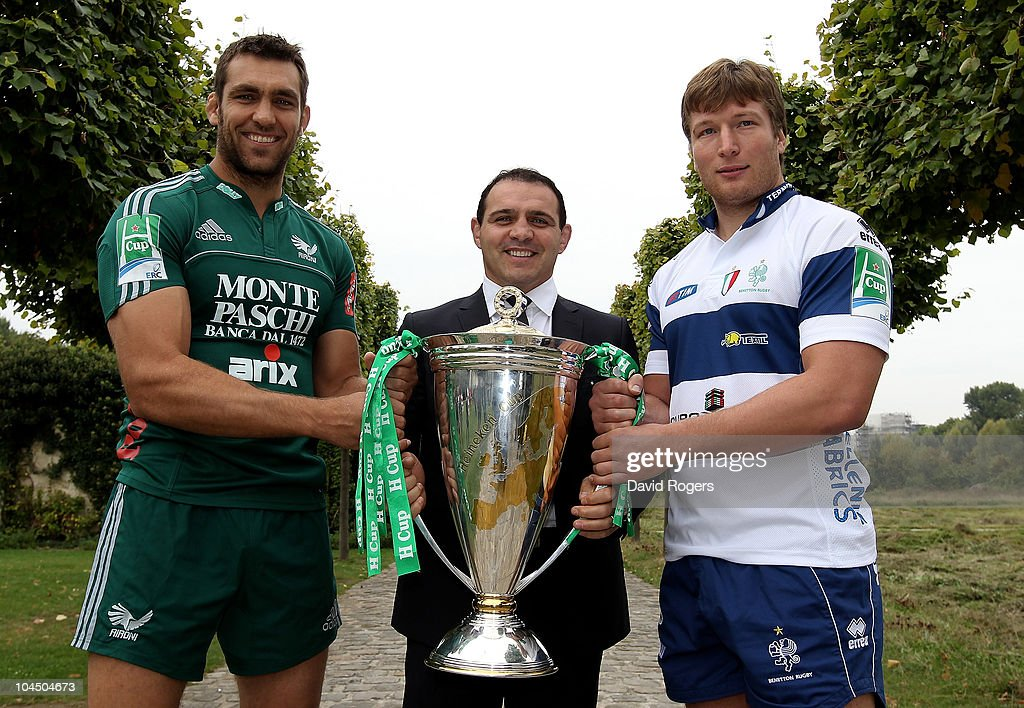 Quintin Geldenhuys,(L) captain of Aironi and Antonio Pavanello, captain of Benetton Treviso pose with the Heineken Cup, with Heineken Cup Ambassador <a gi-track='captionPersonalityLinkClicked' href=/galleries/search?phrase=Raphael+Ibanez&family=editorial&specificpeople=212999 ng-click='$event.stopPropagation()'>Raphael Ibanez</a> (C) during the launch of the Heineken Cup on September 28, 2010 in Paris, France.
