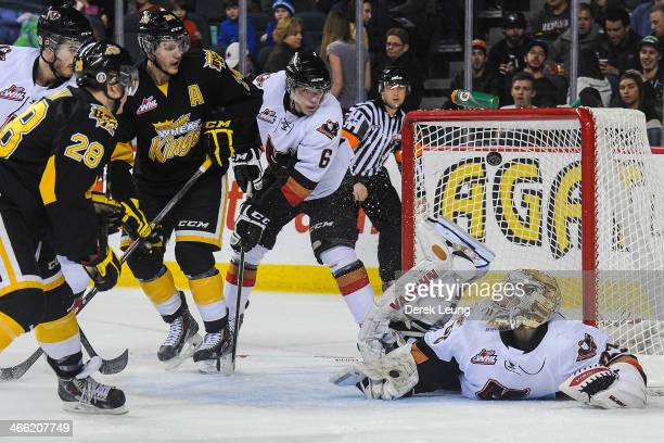 Quintin Lisoway of the Brandon Wheat Kings scores against Chris Driedger of the Calgary Hitmen during a WHL game at Scotiabank Saddledome on January...