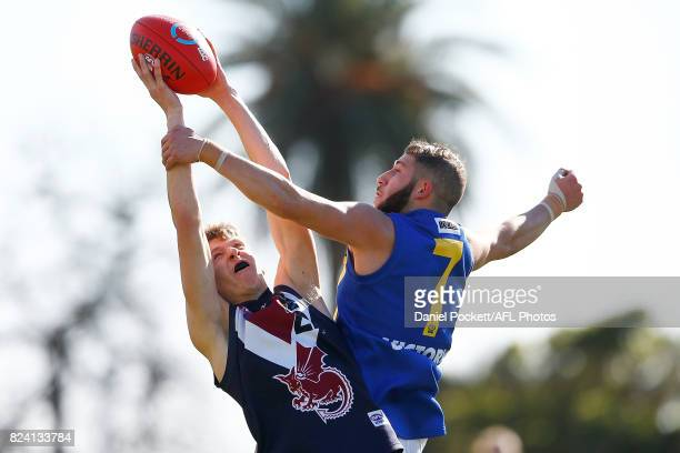 Quintin Montanaro of the Dragons marks the ball under pressure from Jehad Haddara of the Jets during the round 14 TAC Cup match between Sandringham...