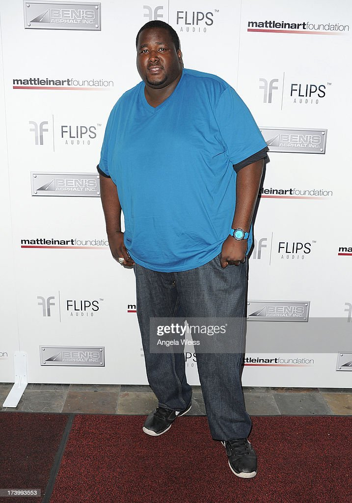 <a gi-track='captionPersonalityLinkClicked' href=/galleries/search?phrase=Quinton+Aaron&family=editorial&specificpeople=6527390 ng-click='$event.stopPropagation()'>Quinton Aaron</a> arrives at the Matt Leinart Foundation's 7th Annual 'Celebrity Bowl' at Lucky Strike Bowling Alley on July 18, 2013 in Hollywood, California.