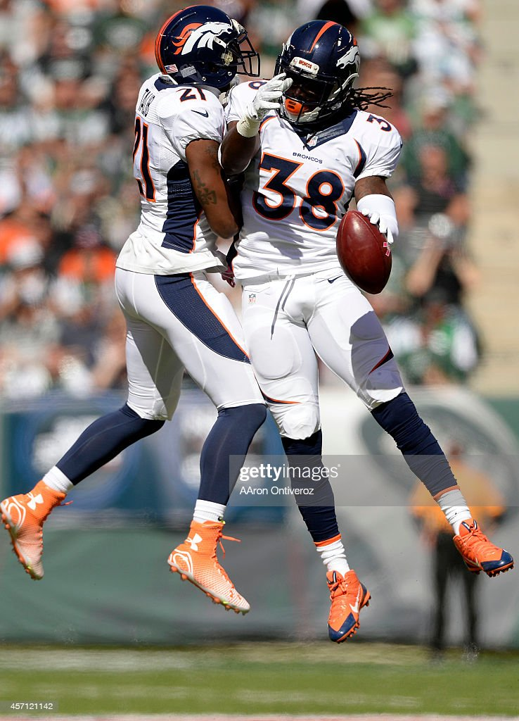 <a gi-track='captionPersonalityLinkClicked' href=/galleries/search?phrase=Quinton+Carter&family=editorial&specificpeople=5631827 ng-click='$event.stopPropagation()'>Quinton Carter</a> (38) of the Denver Broncos celebrates a fumble recovery (it would be ruled down) with <a gi-track='captionPersonalityLinkClicked' href=/galleries/search?phrase=Aqib+Talib&family=editorial&specificpeople=4037138 ng-click='$event.stopPropagation()'>Aqib Talib</a> (21) against the New York Jets during the first half of action at MetLife Stadium. The Denver Broncos visit the New York Jets in a week 5 AFC showdown.