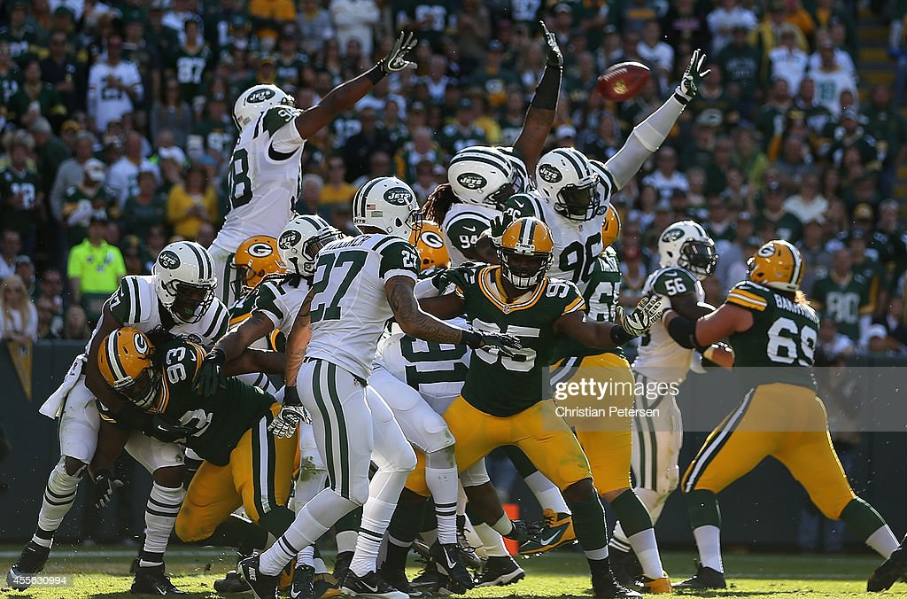 Quinton Coples #98, Damon Harrison #94 and Muhammad Wilkerson #96 of the New York Jets attempt to block a field goal kicked by the Green Bay Packers during the NFL game at Lambeau Field on September 14, 2014 in Green Bay, Wisconsin. The Packers defeated the Jets 31-24.