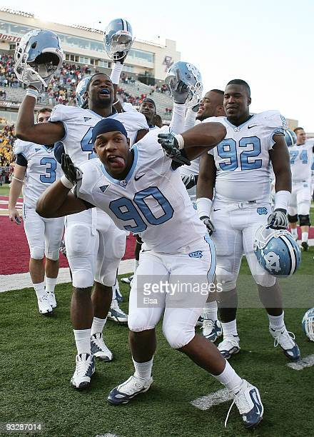 Quinton Coples of the North Carolina Tar Heels and the rest of his teammates celebrate the win over the Boston College Eagles on November 21 2009 at...
