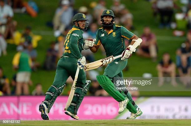 Quinton de Kock and Hashim Amla of South Africa run between the wickets during the 3rd Momentum ODI match between South Africa and England at...
