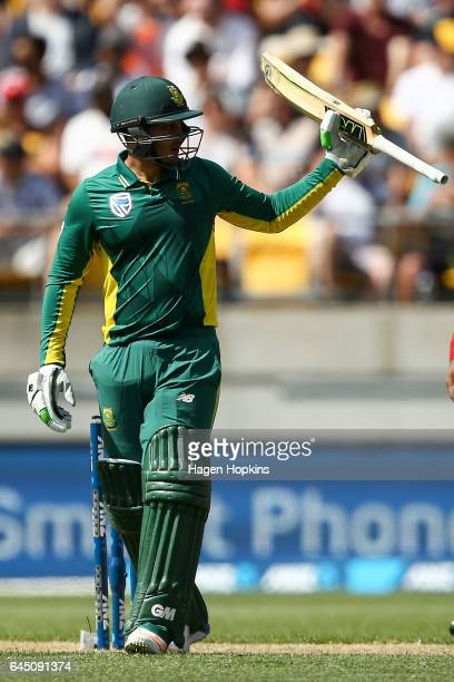 Quinton de Kock of South Africa acknowledges his half century during game three of the One Day International series between New Zealand and South...