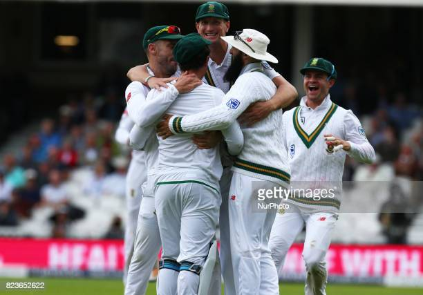 Quinton de Kock of South Africa celebrate the catch of England's Joe Root bowled by Vernon Philander of South Africa during the International Test...