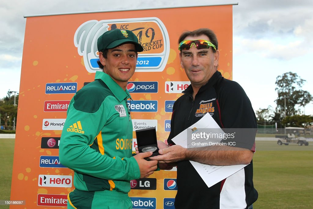 Quinton de Kock of South Africa (L) is awarded Man of the Match in the ICC U19 Cricket World Cup 2012 match between South Africa and Bangladesh at Allan Border Field on August 12, 2012 in Brisbane, Australia.