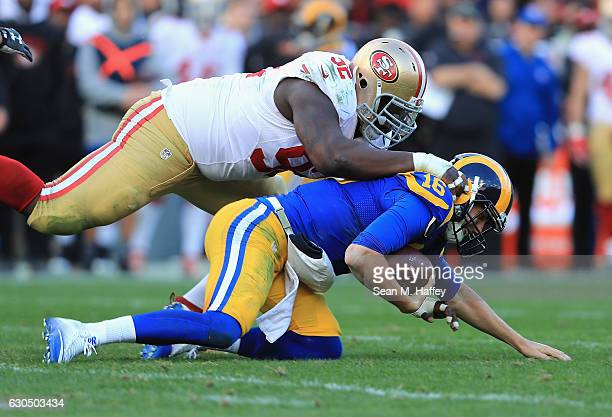 Quinton Dial of the San Francisco 49ers tackles Jared Goff of the Los Angeles Rams during the first half of their game at Los Angeles Memorial...