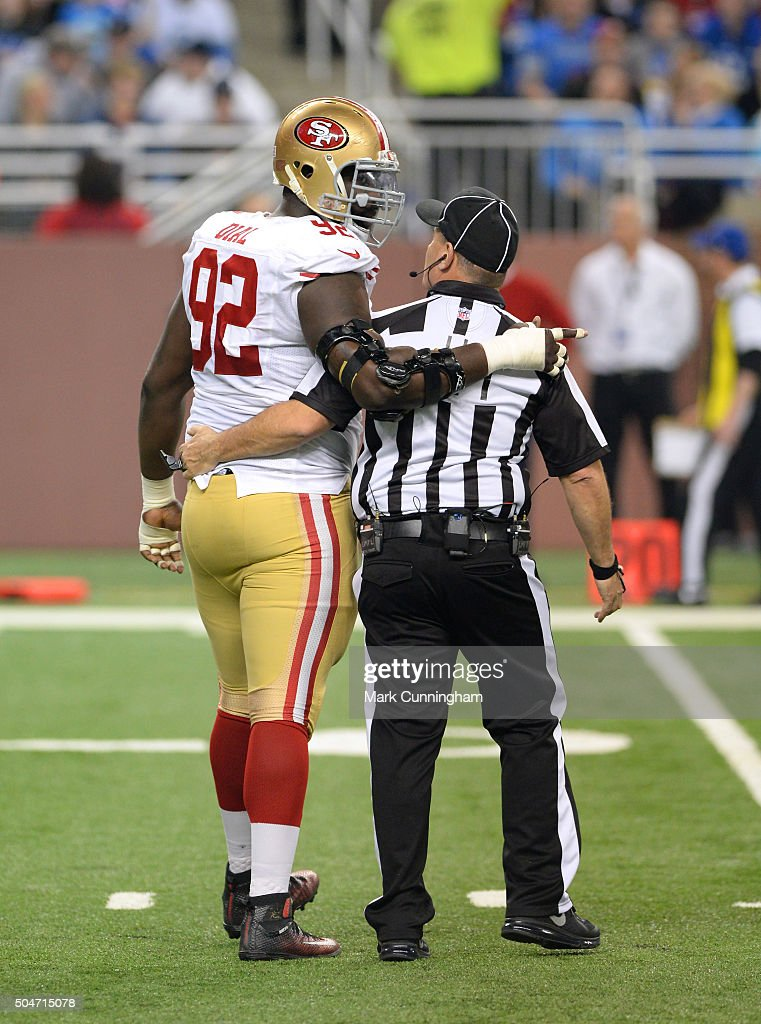 Quinton Dial #92 of the San Francisco 49ers walks along the field with NFL Official Paul King during the game against the Detroit Lions at Ford Field on December 27, 2015 in Detroit, Michigan. The Lions defeated the 49ers 32-17.