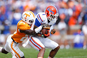 Quinton Dunbar of the Florida Gators makes a reception in front of Michael Williams of the Tennessee Volunteers during the first half of the game at...