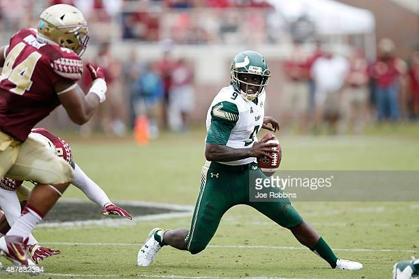 Quinton Flowers of the South Florida Bulls runs the ball in the first half against the Florida State Seminoles at Doak Campbell Stadium on September...