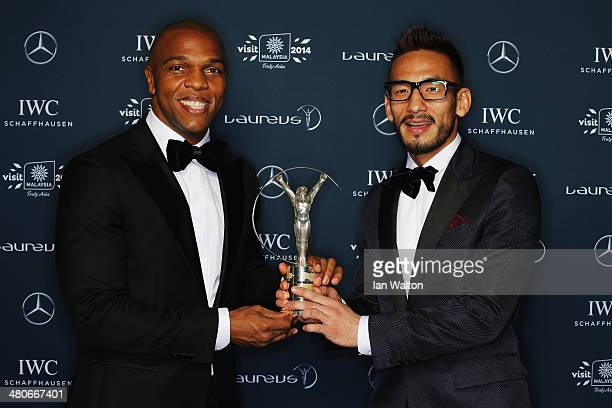 Quinton Fortune and Hidetoshi Nakata pose with the trophy during the 2014 Laureus World Sports Awards at the Istana Budaya Theatre on March 26 2014...