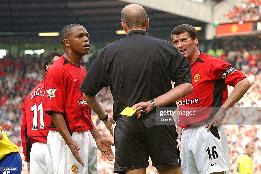 Quinton Fortune and Roy Keane appeal to referee Steve Bennett prior to Keane's booking during the FA Barclaycard Premiership match between Manchester...