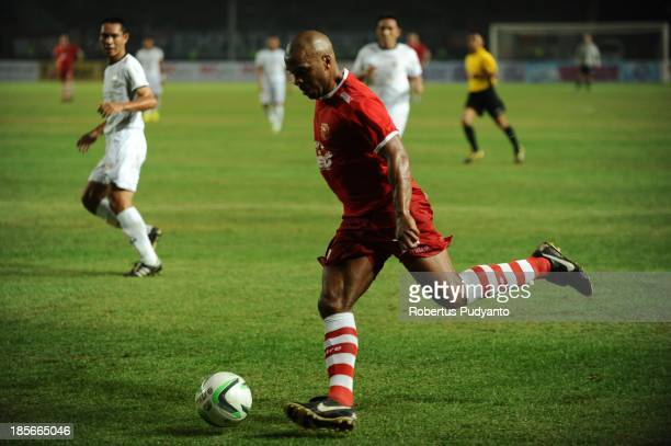 Quinton Fortune controls the ball during the friendly match between Indonesia Red and the Manchester United Legends on October 23 2013 in Jakarta...