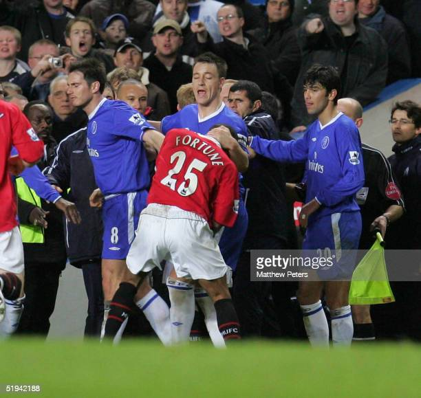Quinton Fortune of Manchester United clashes with Frank Lampard and John Terry of Chelsea during the Carling Cup semifinal first leg match between...