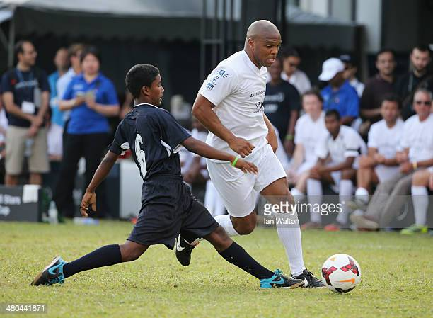 Quinton Fortune of Team YR1M evades a tackle during the Laureus All Stars Unity Cup ahead of the 2014 Laureus World Sports Awards at Royal Selangor...