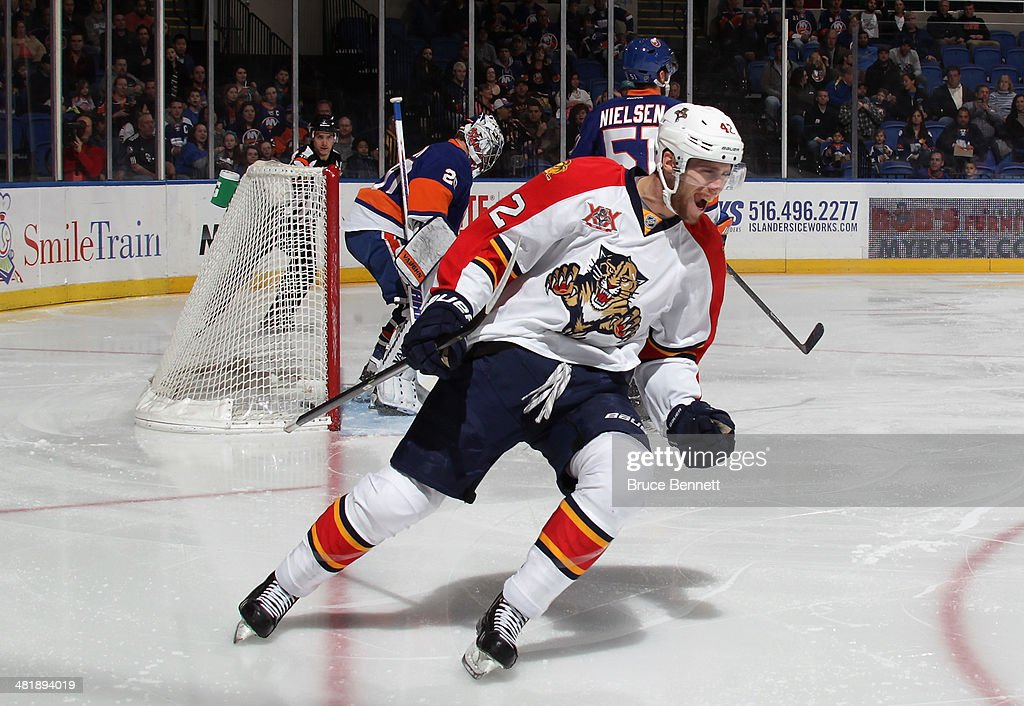 Quinton Howden #42 of the Florida Panthers celebrates his goal at 1:50 of the first period against the New York Islanders at the Nassau Veterans Memorial Coliseum on April 1, 2014 in Uniondale, New York.