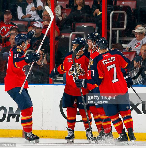 Quinton Howden of the Florida Panthers celebrates his goal with teammates against the New Jersey Devils at the BBT Center on March 14 2014 in Sunrise...