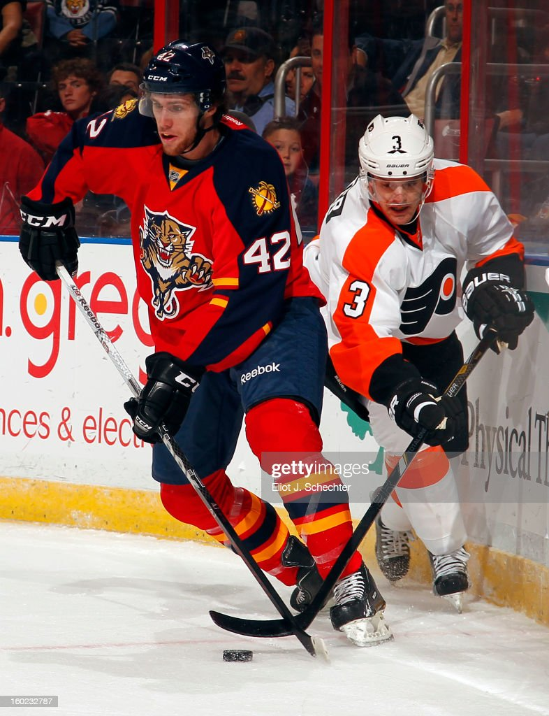 Quinton Howden #42 of the Florida Panthers digs the puck out from the board against Kurtis Foster #3 of the Philadelphia Flyers at the BB&T Center on January 26, 2013 in Sunrise, Florida.
