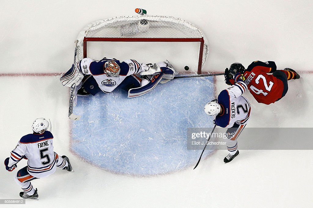 Quinton Howden #42 of the Florida Panthers shoots and scores against Goaltender Cam Talbot #33 along with teammates Mark Fayne #5 and Andrej Sekera #2 of the Edmonton Oilers at the BB&T Center on January 18, 2016 in Sunrise, Florida.