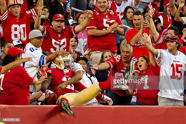 Quinton Patten of the San Francisco 49ers celebrates after blocking a punt for a touchdown against the Dallas Cowboys in the fourth quarter of a...