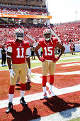 Quinton Patton and Michael Crabtree of the San Francisco 49ers on the field prior to the game against the San Diego Chargers at Levi Stadium on...